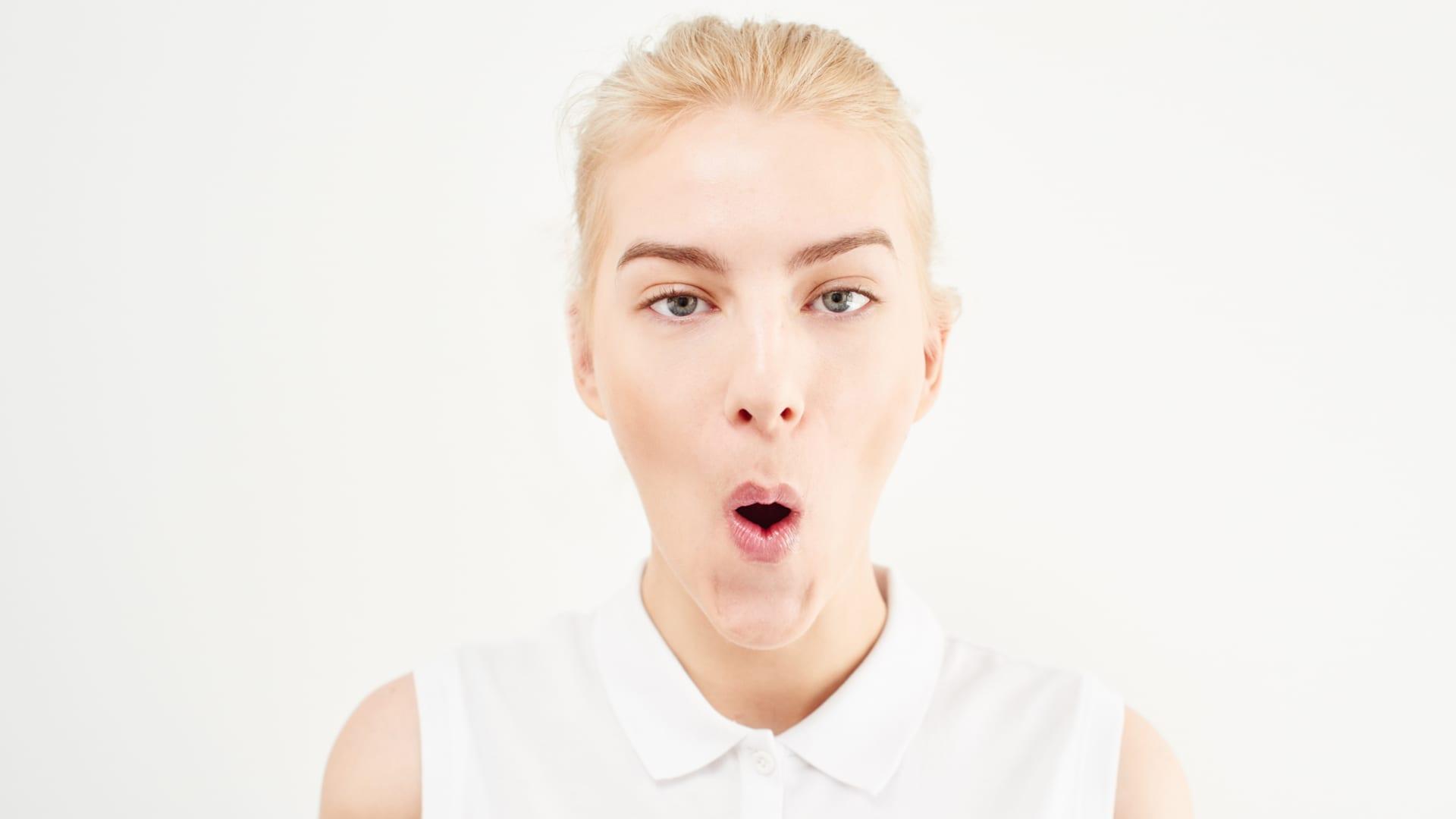 Facial gymnastics: cheekbone lifting exercises.